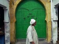 man-by-green-door